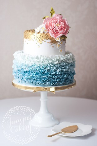 Super pretty ruffled wedding cake with sugar flowers by Juniper Cakery