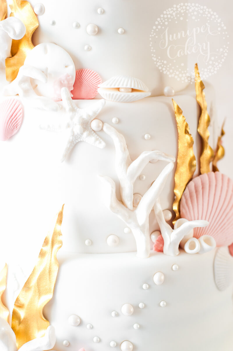 Sea themed wedding cake with 24k gold fondant seaweed by Juniper Cakery