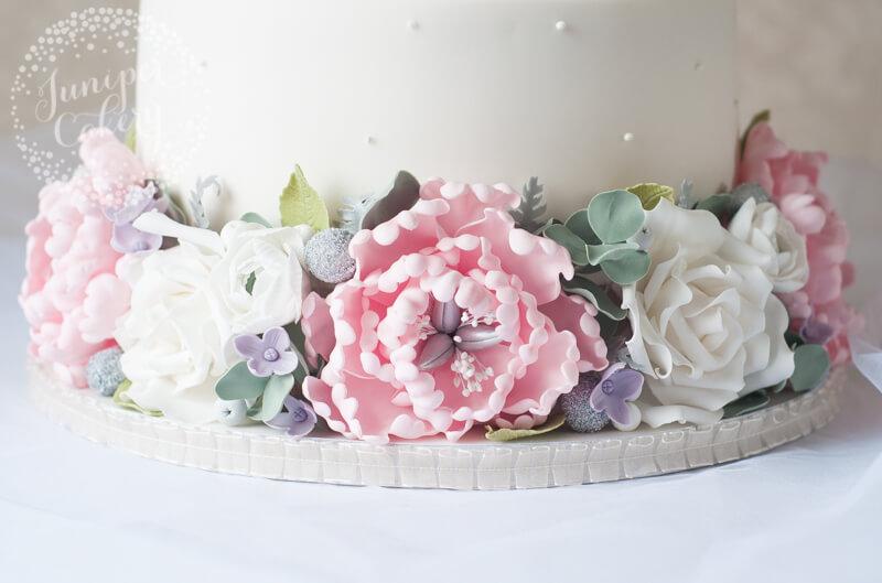 Sugar peony and rose wedding cake design by Juniper Cakery