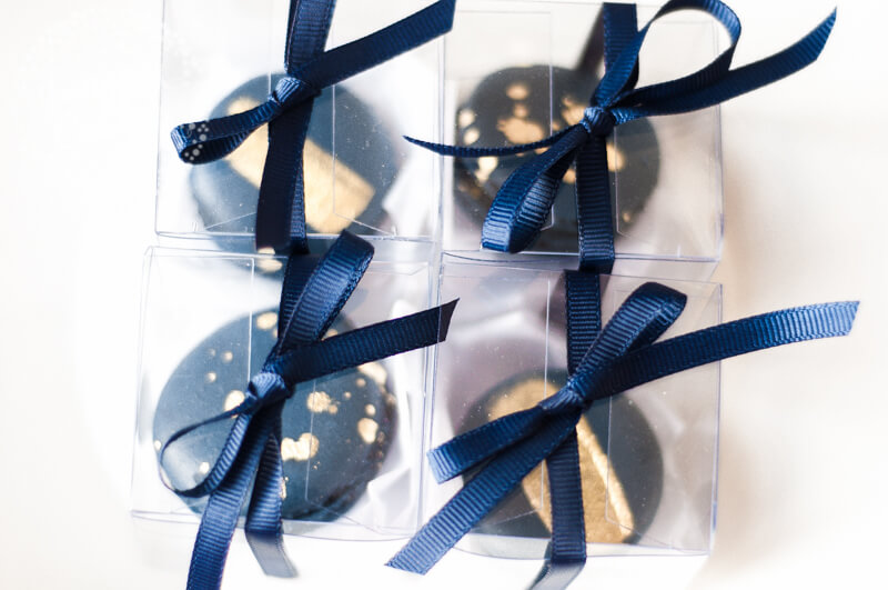 Stylish Navy and 2k Gold Macaron Wedding Favours by Juniper Cakery