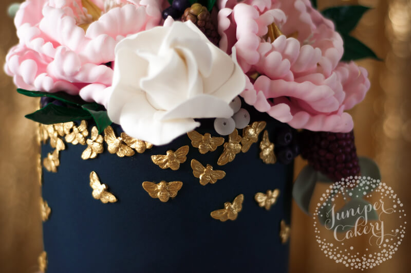Golden bee covered cake by Juniper Cakery