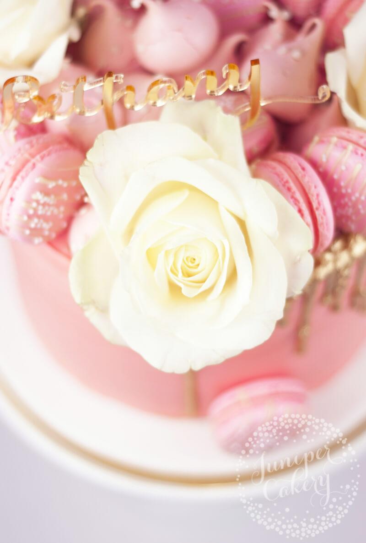 Cute gold drip cake by Juniper Cakery