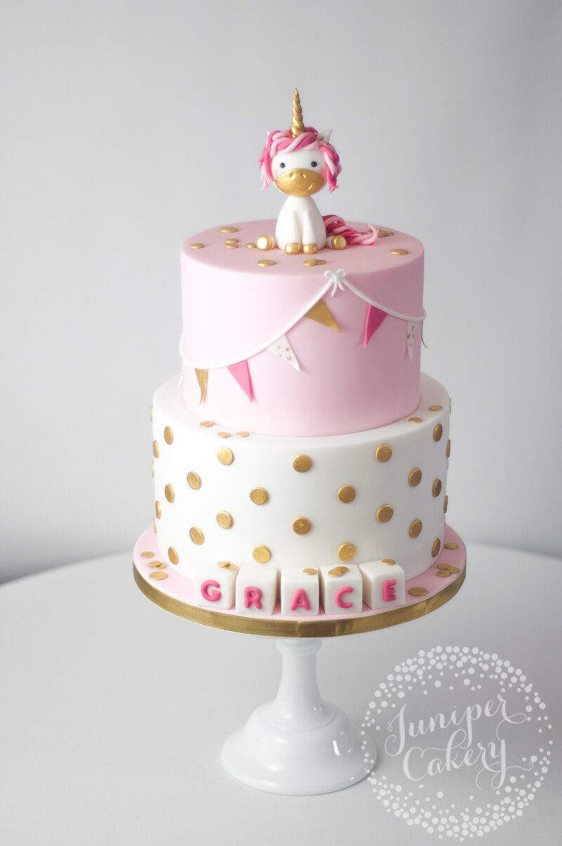 Cute pink unicorn Christening cake by Juniper Cakery