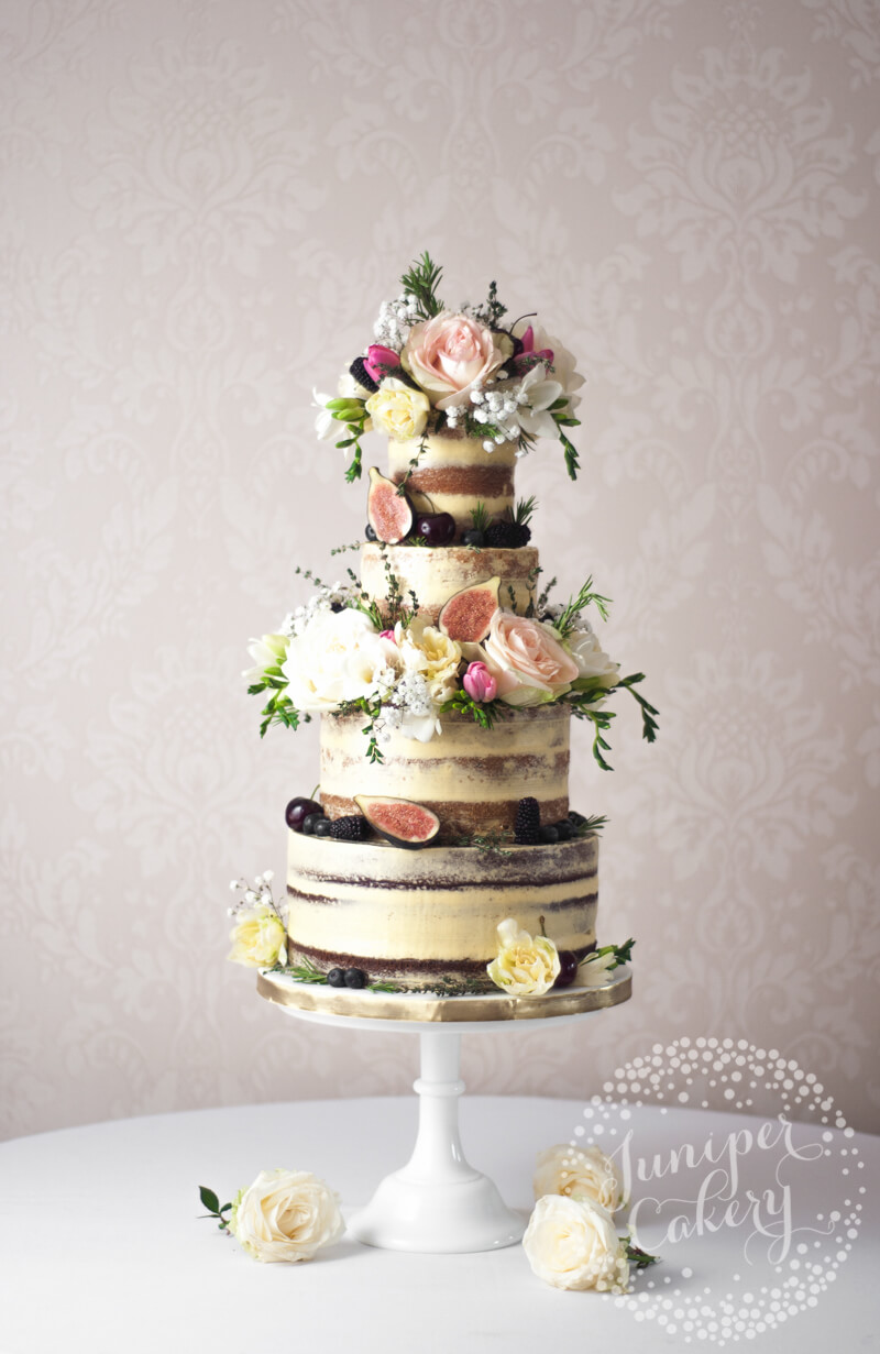Wild countryside semi-naked wedding cake by Juniper Cakery