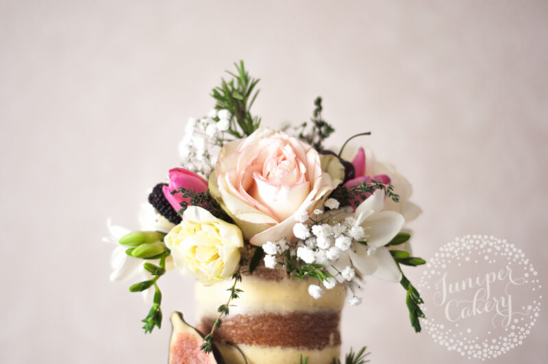 Gorgeous English countryside semi-naked wedding cake by Juniper Cakery