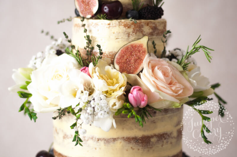 Beautiful English countryside semi-naked wedding cake by Juniper Cakery