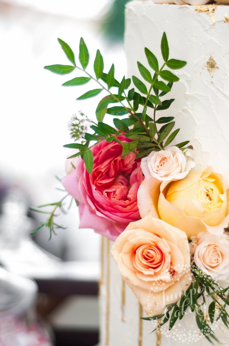 Fresh rose wedding cake by Juniper Cakery