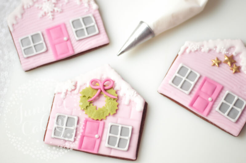 Learn to create cute gingerbread house cookies by Juniper Cakery