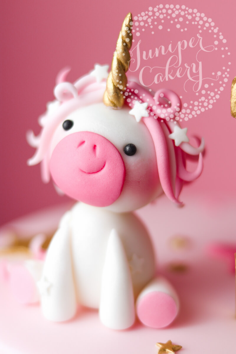 Adorable pink fondant unicorn by Juniper Cakery