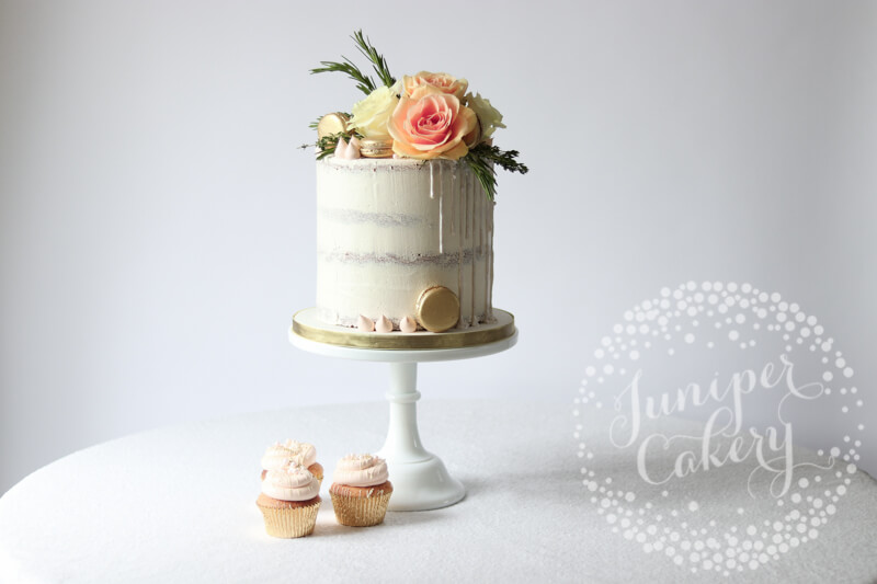 White semi-naked cake with white shimmer sequin drip by Juniper Cakery