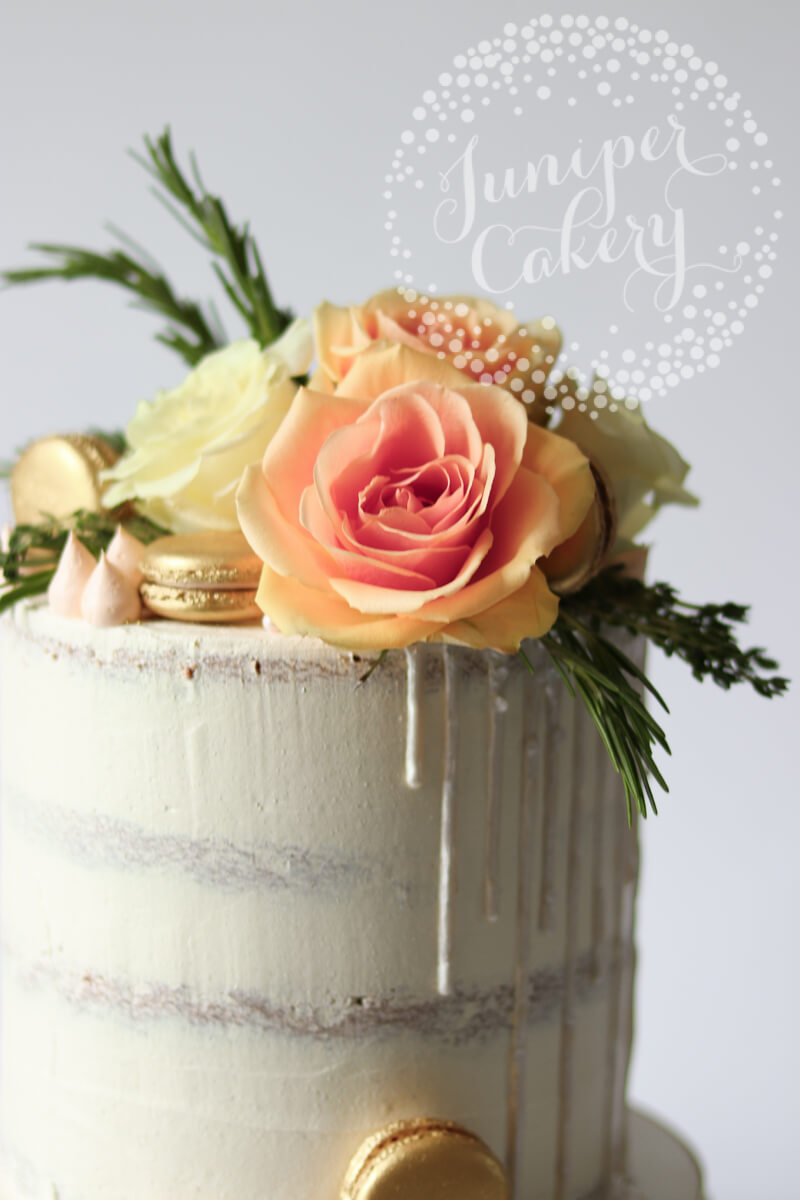 White cake with peach ombré roses by Juniper Cakery