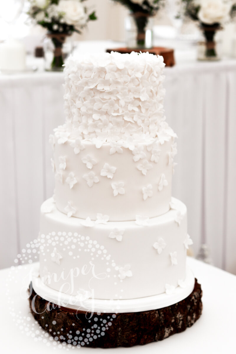 White sugar hydrangea blossom wedding cake by Juniper Cakery