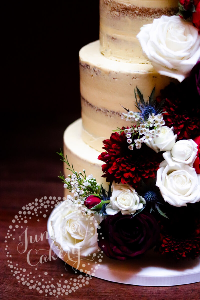 Dramatic berry, burgundy and navy wedding cake by Juniper Cakery