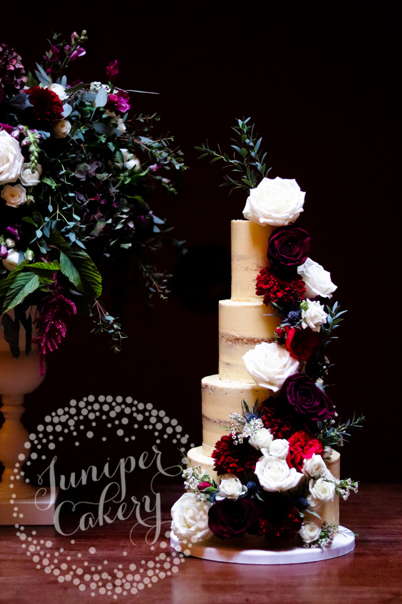 Stunning berry and navy wedding cake at Rise Hall by Juniper Cakery