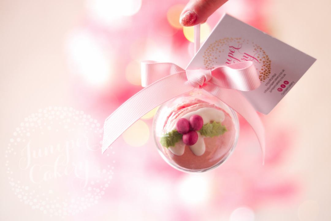 Blush pink macaron bauble for Christmas by Juniper Cakery