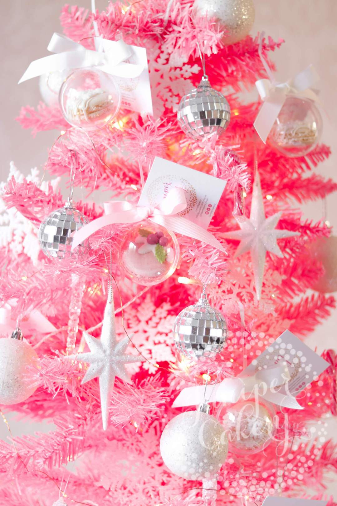 Baubles on pink Christmas tree by Juniper Cakery