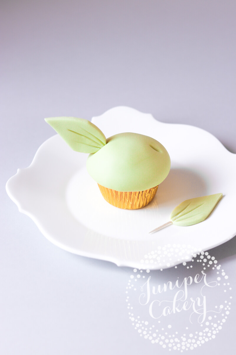 Fun Baby Yoda cupcake by Juniper Cakery