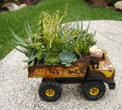 plant container for gardening - old toy truck