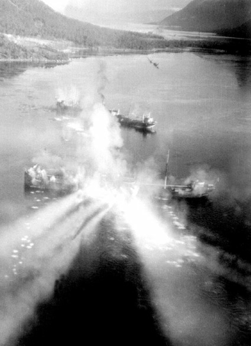 A Beaufighter, flown by Lt L.C. Boileau, 404 Squadron, firing rockets at German merchantmen Aquila and Helga Ferdinand near Fjord Migdulen, November 8th, 1944. Both ships were sunk.