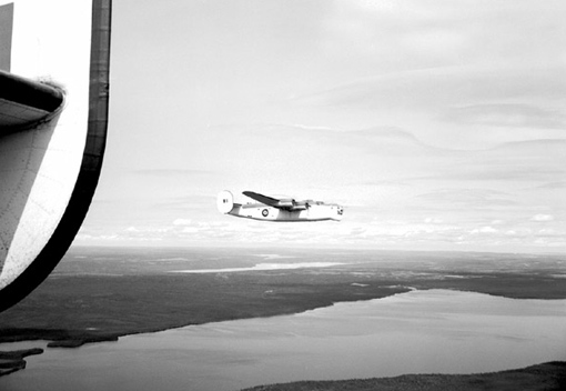 "Liberator ""P"" of 10 (BR) Squadron patrolling over Newfoundland's coast, spring 1943."
