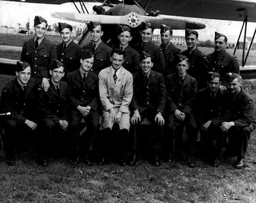 A group photograph is taken after each step of the training programme. Here, trainees at Manning Depot No 5 in Lachine, Quebec, with instructor V. Beauvilliers, 13th June, 1943.