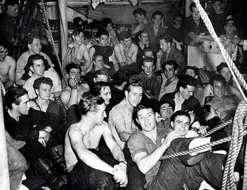 Crew watching film in mess deck of RCN ship. By 1942 the Volunteer Reserve made up for the majority of the RCN's personnel.