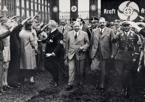 Prime Minister W.L. Mackenzie King receiving Nazi salute, Berlin, June 1937.