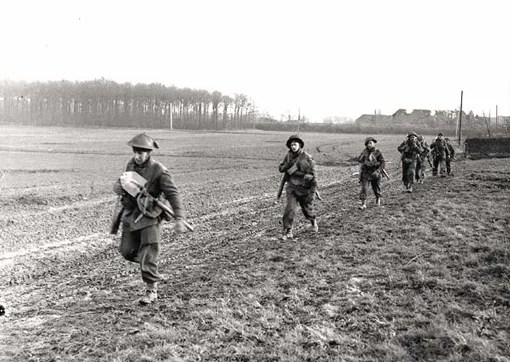 Algonquin Regiment moving forward near the Hochwald Forest, Udem, Germany, March 1st, 1945.
