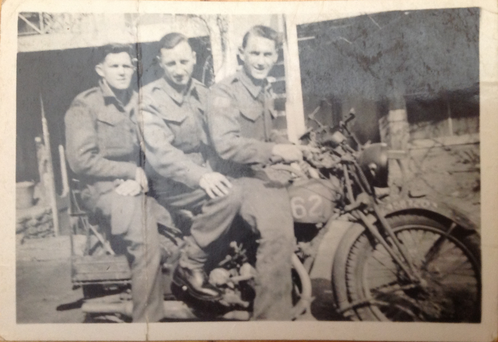 Harold Daley, Jim McLaughlin and unknown on motorbike in England