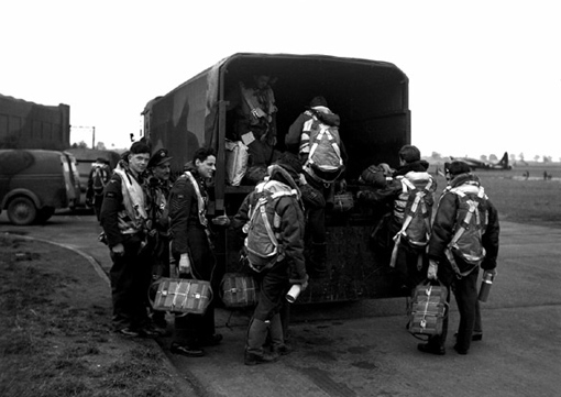 Crews of 425 Squadron board a truck for a drive out to their Wellingtons at Dishforth.