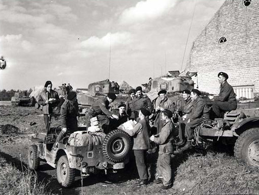 """The mail jeep of the """"A"""" Squadron of the Fort Garry Horse making its first stop for deliveries in France or Belgium, 11 October 1944."""
