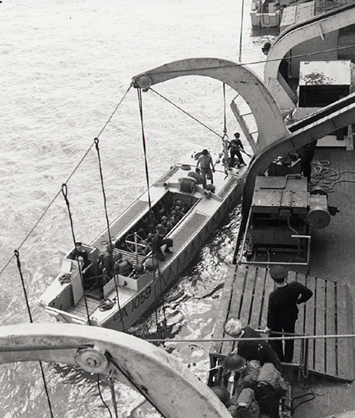 LCA 1050 leaving side of HMCS Prince David, loaded with soldiers of the Régiment de la Chaudière, 9 May 1944.