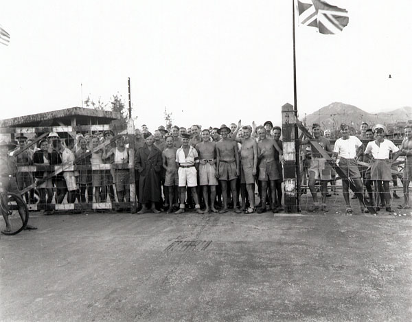 Canadian and British prisoners of war awaiting liberation by landing party from H.M.C.S. Prince Robert, Hong Kong, 30 August 1945.
