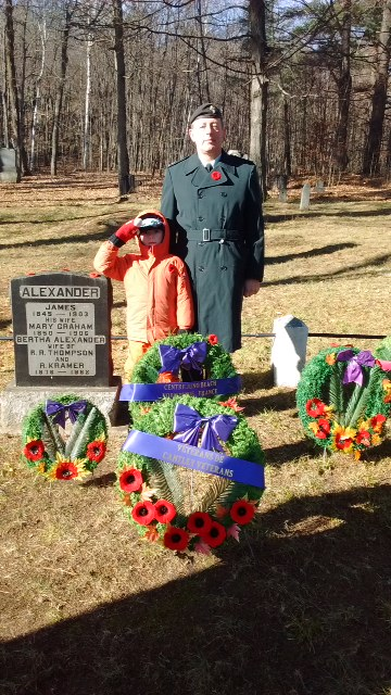 Duncan and his dad, a Canadian Forces member, showing their respect.