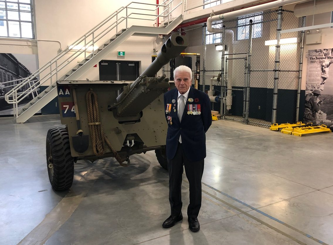 WW2 Veteran, who participated in the Liberation of The Netherlands, poses in front of a 25-pounder gun in Vancouver