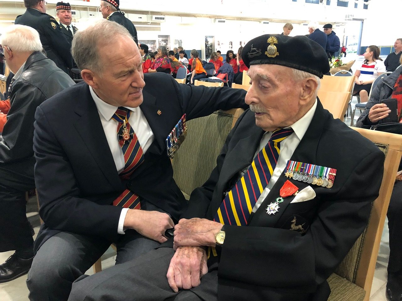 General Walt Natynczyk, Deputy Minister, Veterans Affairs, Government of Canada speaks with World War 2 Veteran Frank Milledge of the Sherbrooke Fusiliers