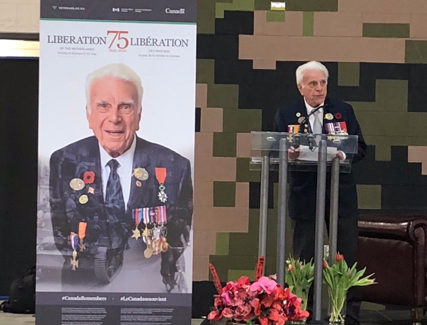 WW2 Veteran Norm Kirby speaks at the unveiling of Veterans Affairs Canada's official poster for the commemoration of the 75th anniversary of the Liberation of The Netherlands and V-E Day.