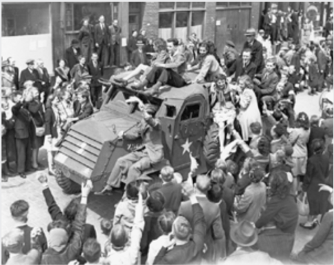 Dutch citizens celebrate the liberation of Rotterdam. Liberated Dutch often climbed onto tanks to ride along with their Canadian liberators