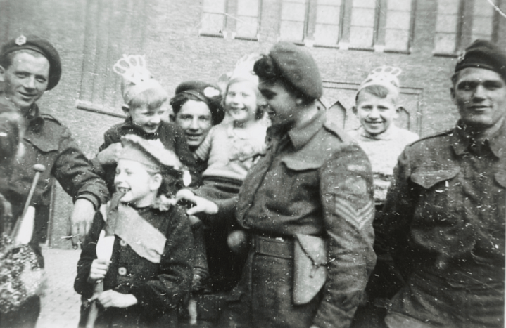 Canadian soldiers celebrate with Dutch children. Canadian soldiers liberated Groningen during the Liberation of The Netherlands in WW2.