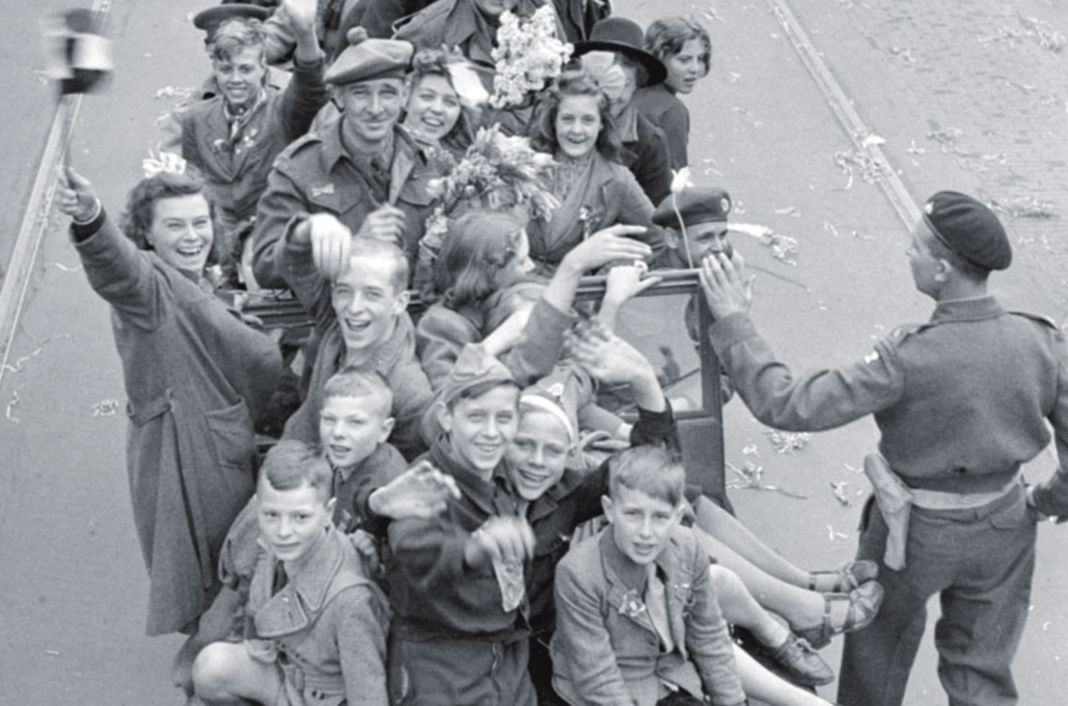 Happy Dutch citizens cheer Canadian soldiers who liberated them in Utrecht during World War 2.