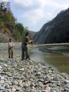 Andrew playing a mahseer on the Ramganga river