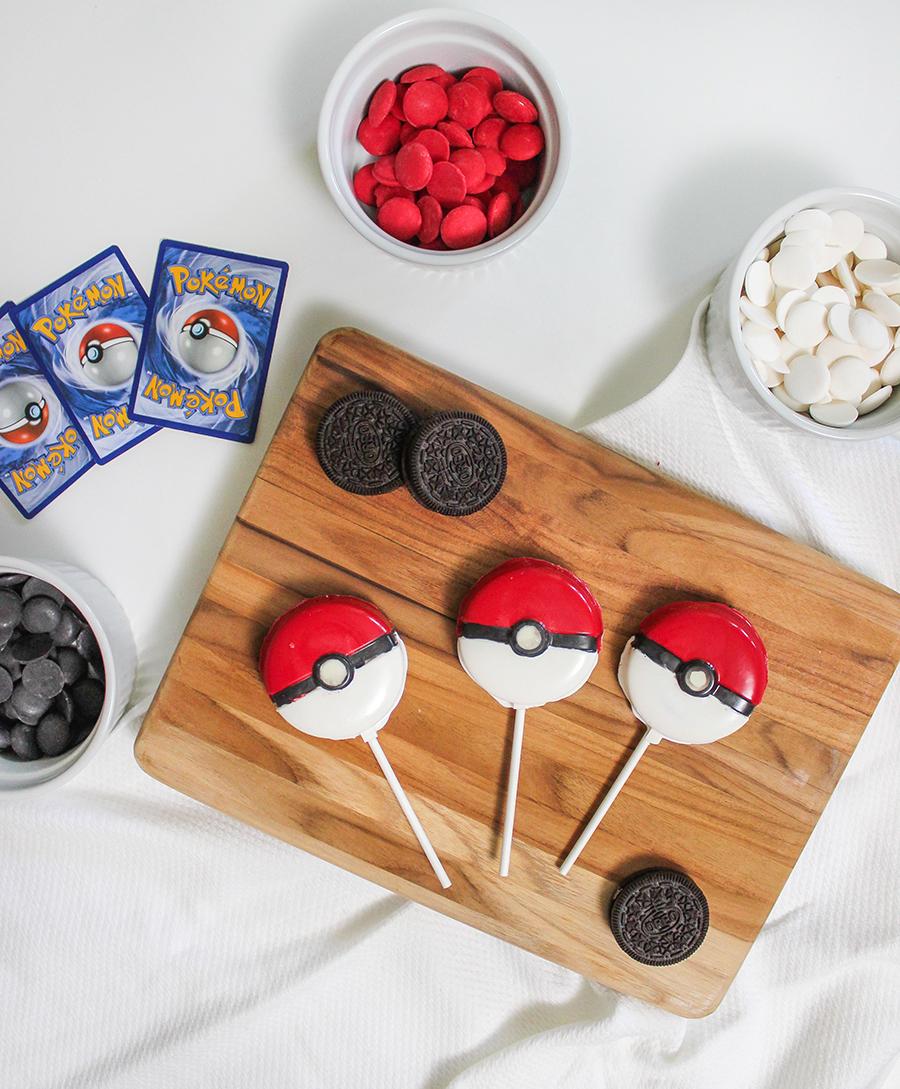 Easy DIY Pokemon Oreo Pops, poke ball pops, oreo pops, food fun, Just Add Confetti, pokemon party foods, party food, creative food idea, party food ideas, Pokemon Oreo Pops, Pokemon party, step-by-step tutorial, Pokemon, Poke ball, Oreo