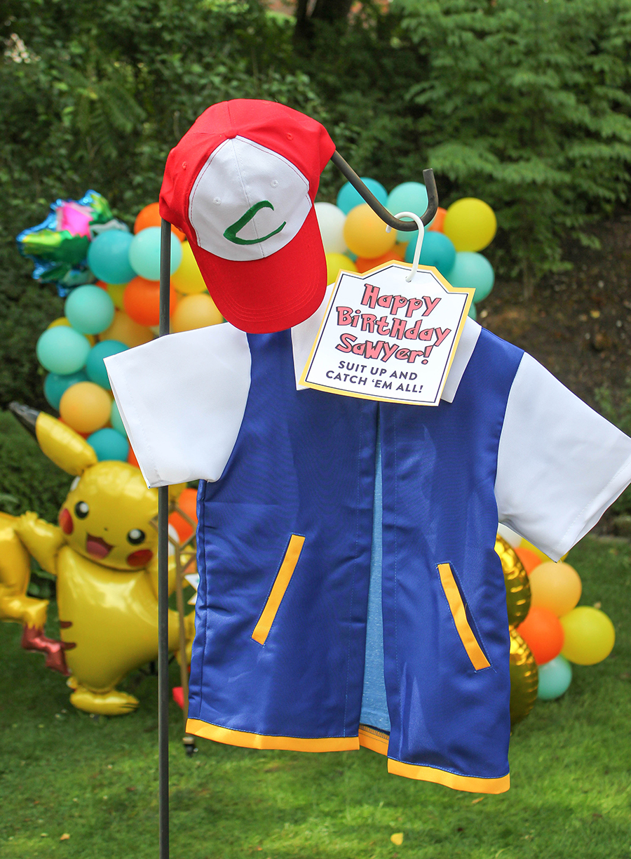 Pokemon birthday party, pokemon, pokemon party, pokemon DIY, pokemon birthday cake, pokemon birthday party ideas, DIY Pokemon cake, Pikachu, Pikachu cake, Poke ball oreo pops, poke ball, Pikachu ice cream cone, Pikachu balloon, Pokemon punch game, Poke-a-ball, creative gift packaging, poke ball gift box, DIY pokemon gift box, Just Add Confetti, kids birthday, DIY decorations, Sawyer's Pokemon Birthday Party, homemade cake, DIY cake, Oreo pops, poke ball pops, pikachu ice cream,