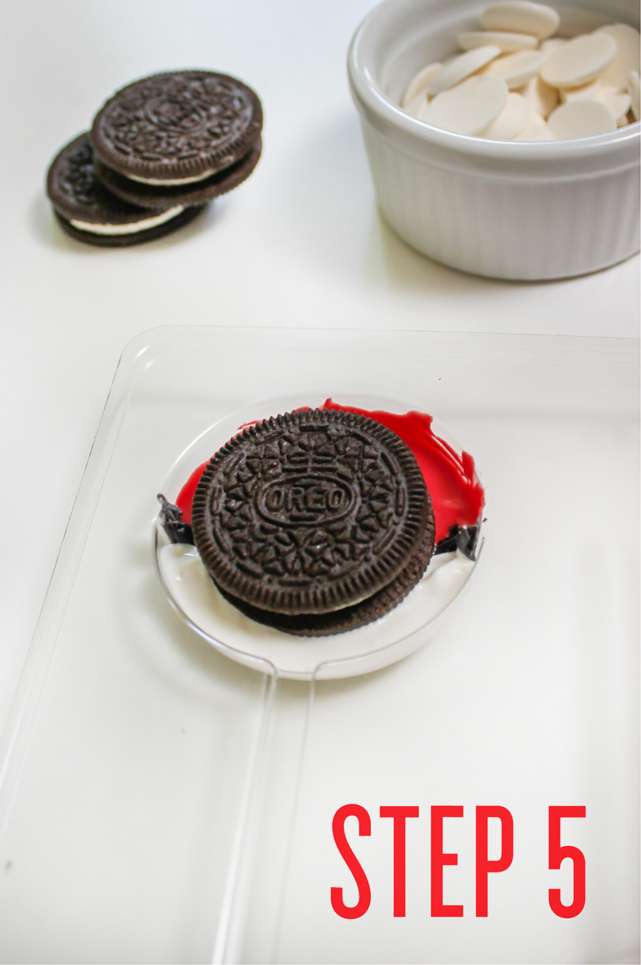 Easy DIY Pokemon Oreo Pops, poke ball pops, oreo pops, food fun, Just Add Confetti, pokemon party foods, party food, creative food idea, party food ideas, Pokemon Oreo Pops, Pokemon party, step-by-step tutorial, Pokemon, Poke ball, Oreo