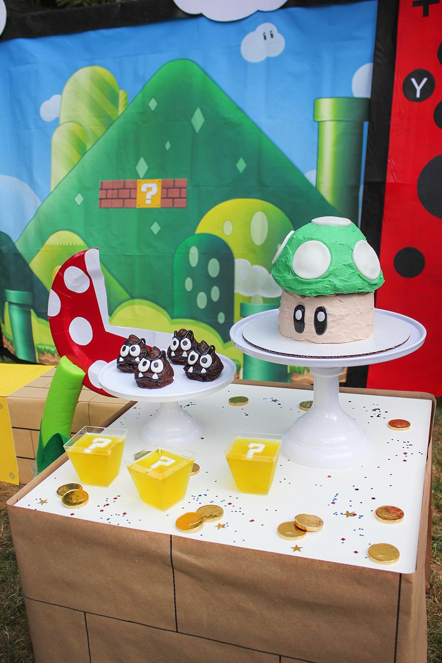 Super Mario Birthday Party, Super Mario birthday cake, Mario birthday party food ideas, mario birthday party games, super mario birthday theme, super mario party printables, mario, luigi, nintendo switch, switch backdrop, yoshi, yoshi eggs, toad cake, goomba, goomba cakes, coin box punch box, punch box, prize punch box, mario coin block, mario coin box, Just Add Confetti, diy decorations, diy party decor, diy nintendo switch, party ideas, party food, party games