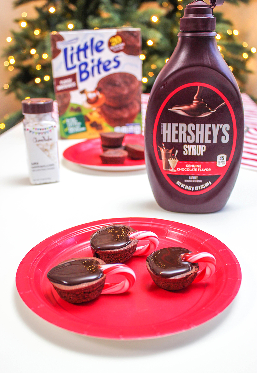 hot cocoa brownie bites, Little Bites, hot cocoa cups, brownie bite hot cocoa cups, the easiest hot cocoa brownie bites, Just Add Confetti, Christmas treat, holiday treat, holiday sweet, holiday treat for kids, Christmas treat, Christmas treats for kids, Christmas treat ideas, easy Christmas treats, Hershey's syrup, mini marshmallows, mini candy canes, Little Bites brownies, 4 ingredients