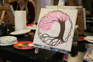 finished tree with pink flowers and within the circle on a gold background