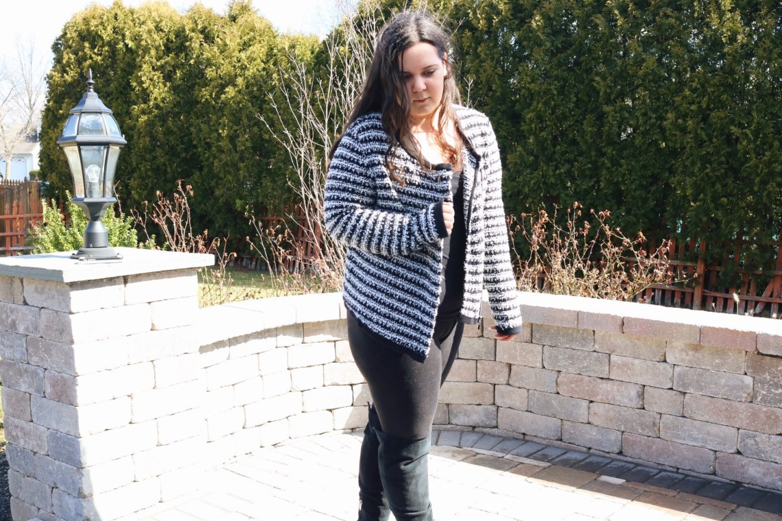 me in an all black outfit with a black and white striped jacket