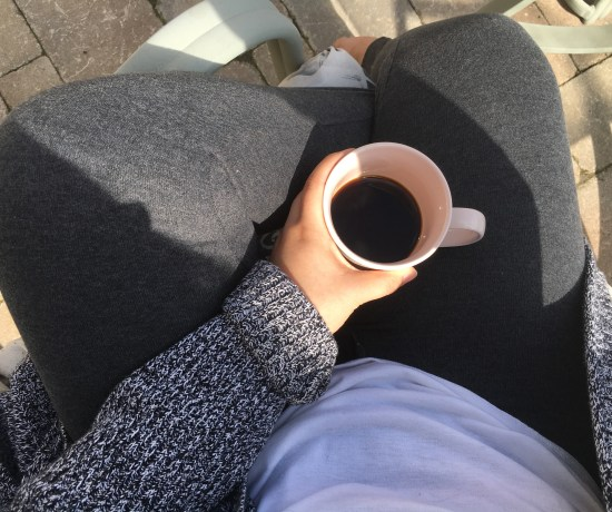 photo of me sitting with a cup of coffee