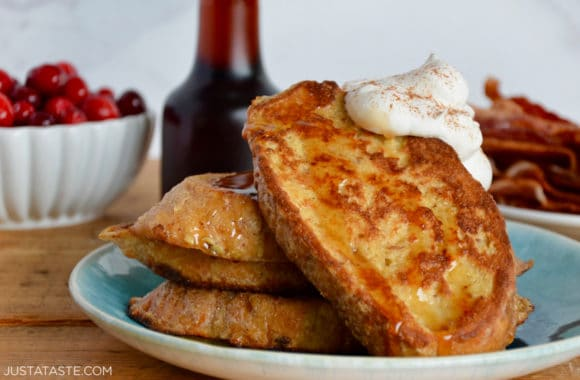 Homemade Eggnog French Toast topped with whipped cream